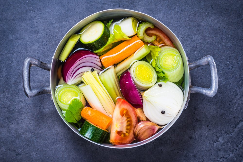 Cut vegetables in a pot to make Homemade Vegetable Broth